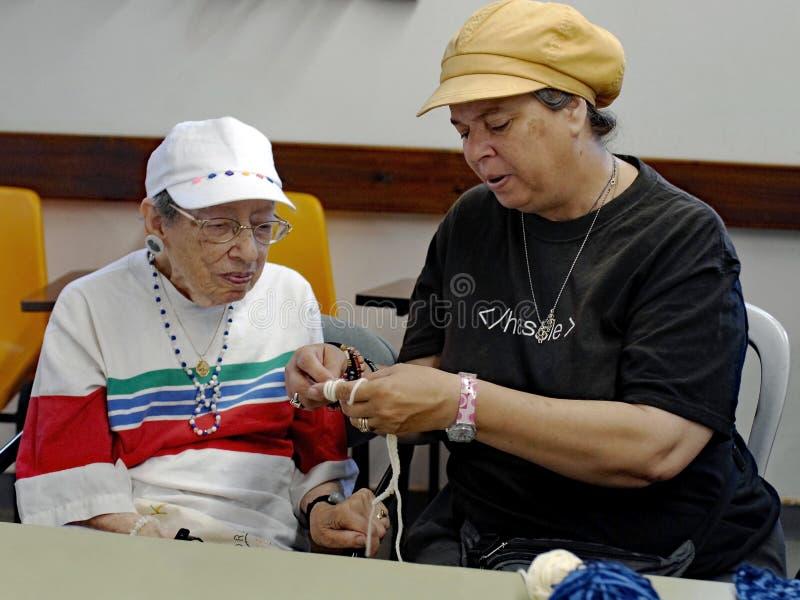 Senior Citizen Learning to Crochet royalty free stock image