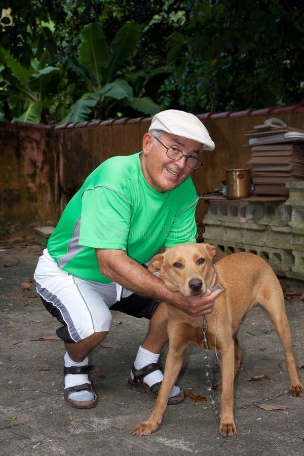 Senior Citizen Man and His Dog stock photography