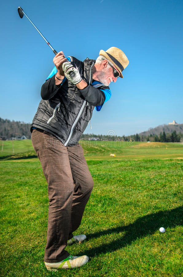 Senior citizen is playing golf royalty free stock photography