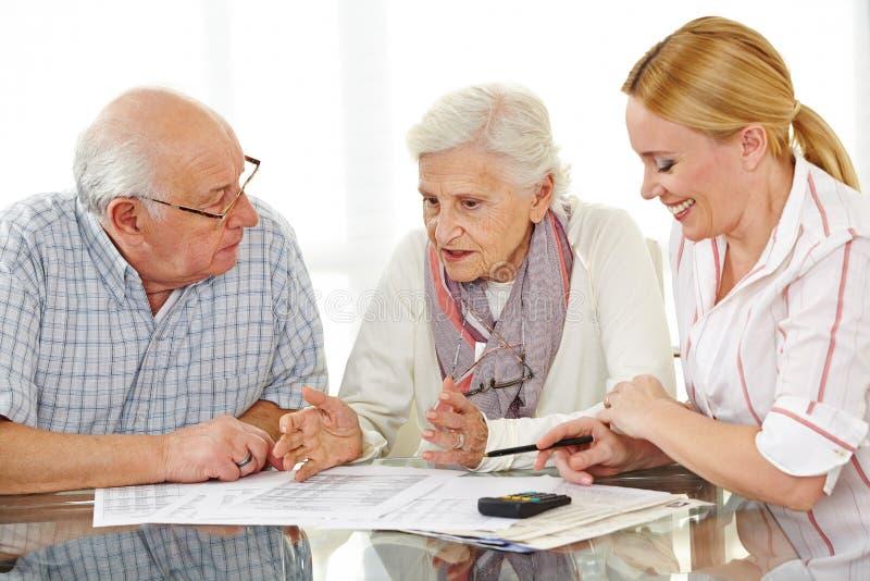Senior citizens couple argueing. Over a contract with financial advisor stock photos