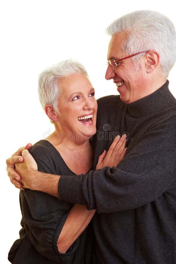 Senior citizens having fun. Two senior citizens smiling at each other royalty free stock photo