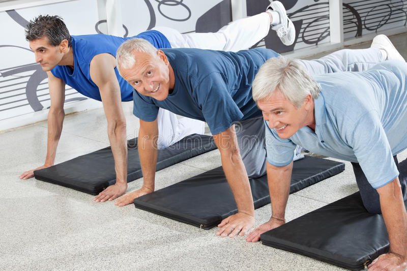 Senior citizens training in fitness. Three senior citizens training together in fitness center royalty free stock images