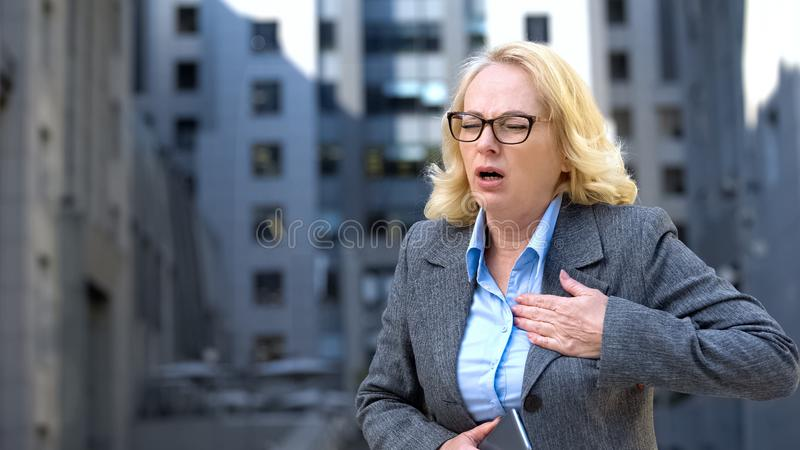 Senior company employee suffering heart attack at work, chest pain, health. Stock photo royalty free stock photo