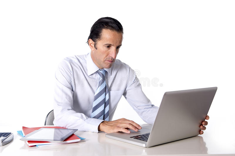 Senior confident businessman working at computer office desk isolated on white background stock photo