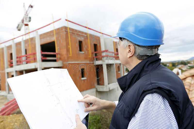 Senior construction manager on building site royalty free stock images