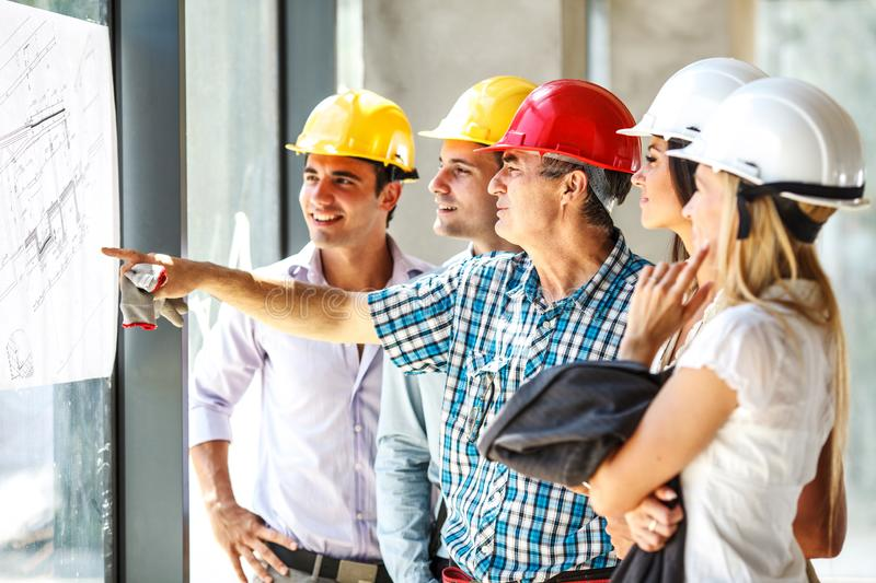 Senior construction manager and group of architects and experts discuss about construction project. stock image