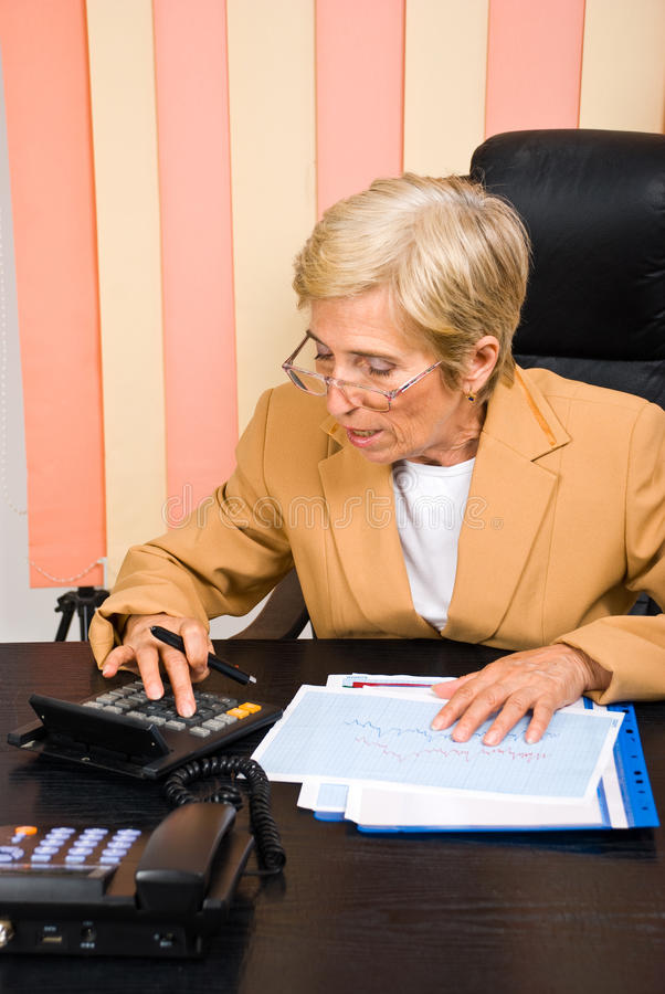Download Senior Corporate Woman Making Calculations Stock Photo - Image: 14929406