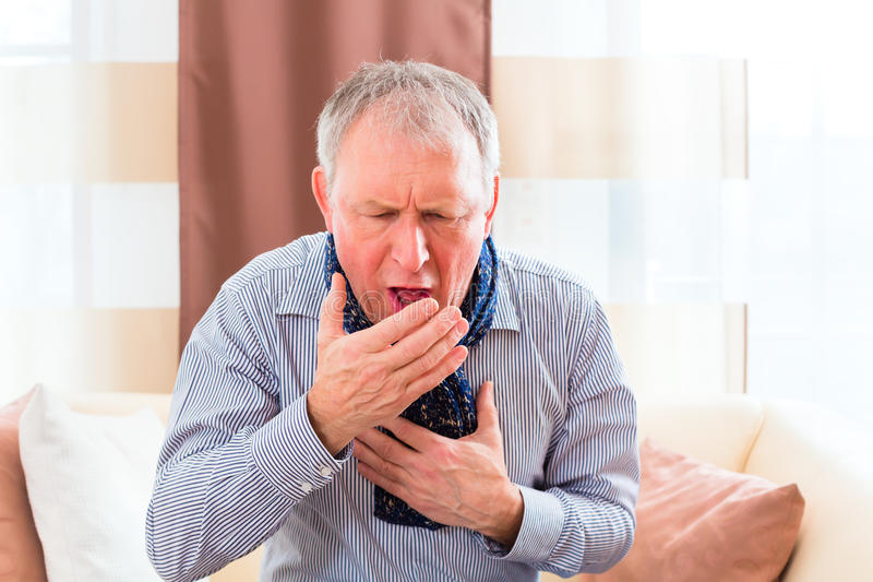 Senior coughing and having the flu royalty free stock image