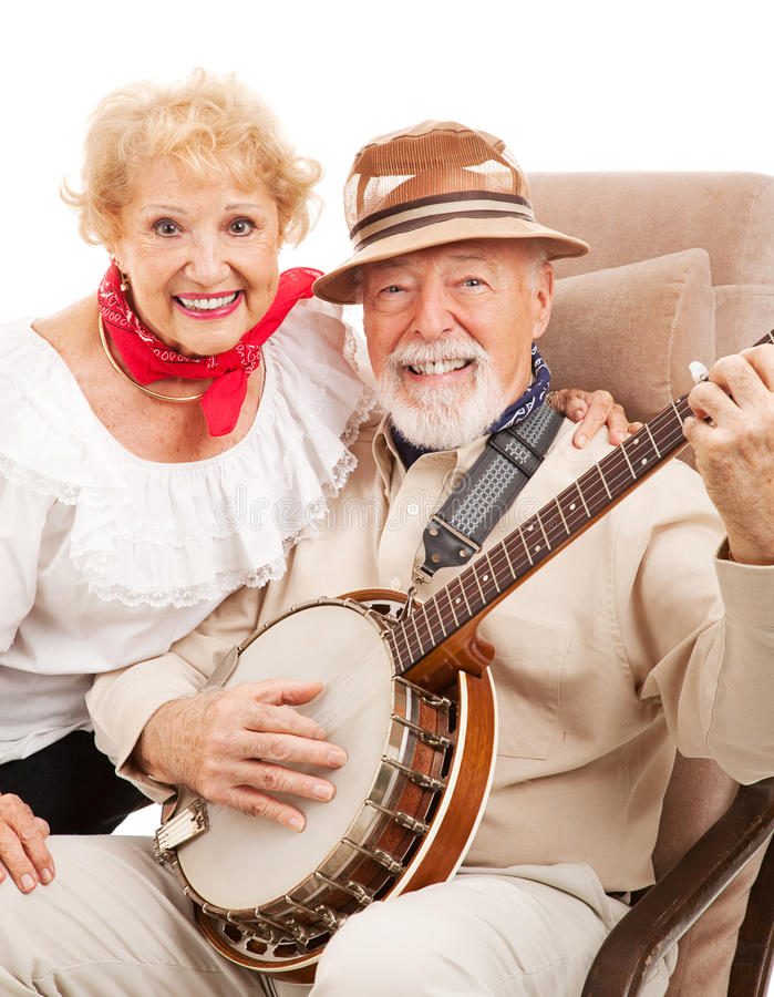 Senior Country Music Couple. Portrait of senior couple who play banjo and sing country music royalty free stock images