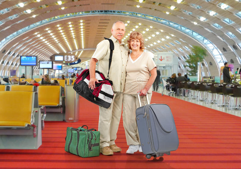 Senior couple. With bags at airport