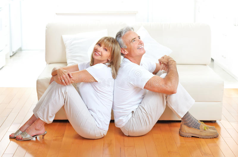 Senior couple. Seniors couple at home smiling and happy royalty free stock image