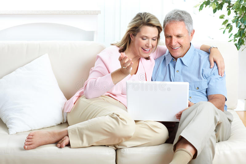 Senior couple. Working with laptop at home stock image