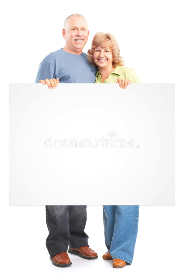 Senior couple. Happy elderly seniors couple in love. Isolated over white background stock images