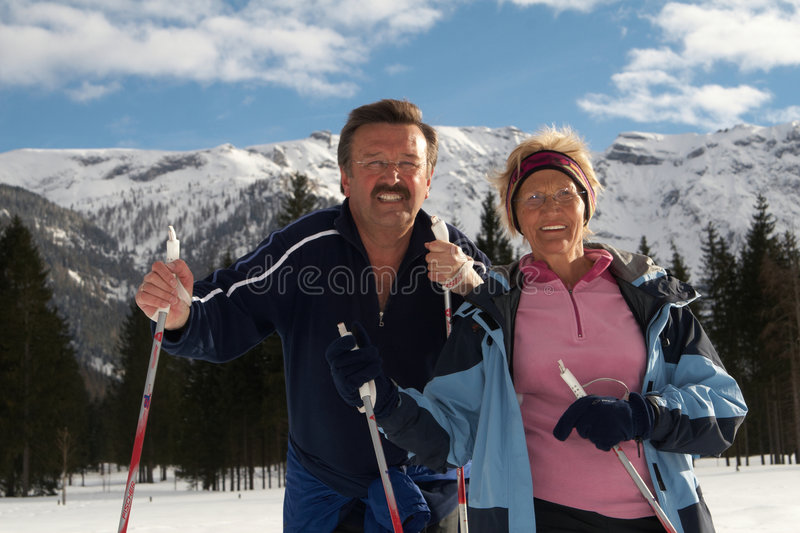 Senior couple. A senior couple outdoor in a winter setting. The active couple is about to go crosscountry skiing royalty free stock image