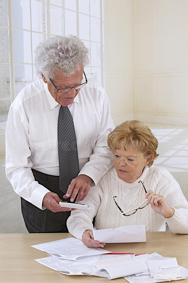 Senior couple with administratives papers stock photo