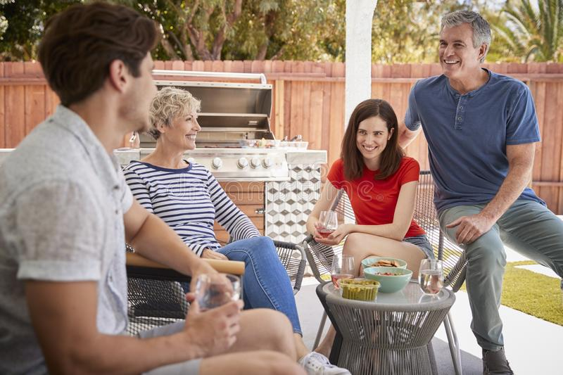 Senior couple and adult children on the porch outside house royalty free stock photo