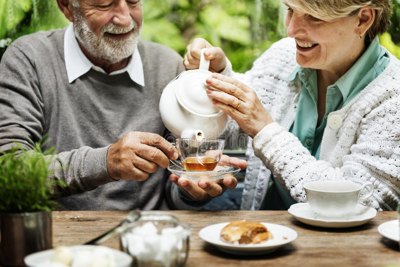 Senior Couple Afternoon Tea Drinking Relax Concept stock image