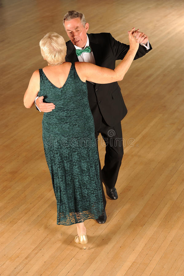 Senior couple ballroom dancing stock images