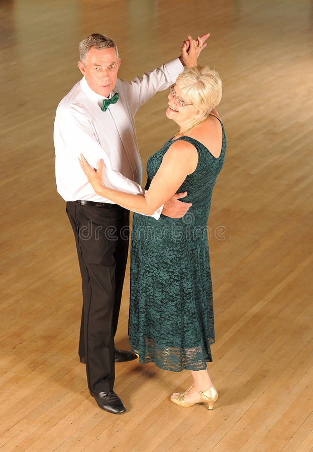 Senior couple ballroom dancing stock photography