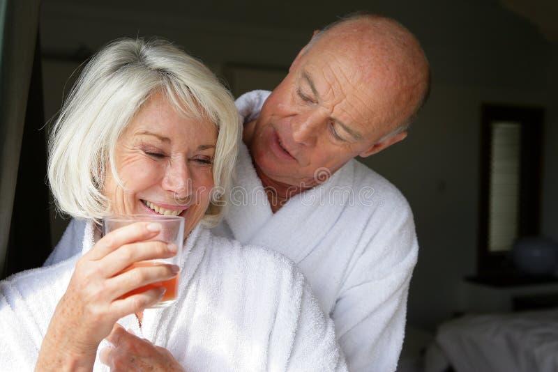 Senior Couple In Bathrobe Royalty Free Stock Photo