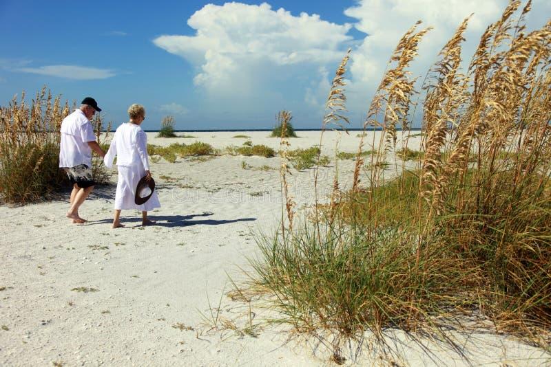 Senior couple on beach royalty free stock photo