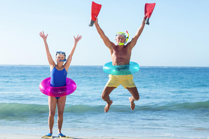 Senior couple with beach equipment royalty free stock image