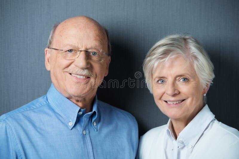 Senior couple with beautiful friendly smiles royalty free stock photo