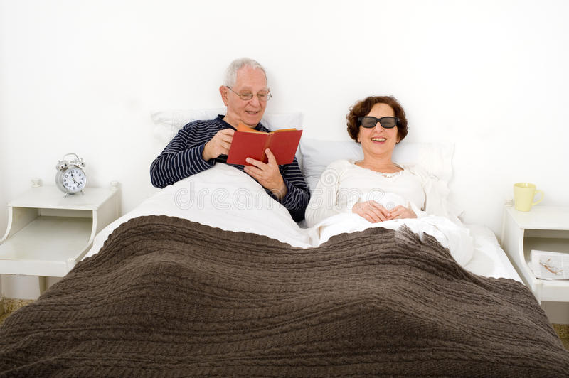 Download Senior couple in bed stock image. Image of bonding, image - 13780641