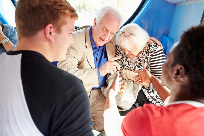 Senior Couple Being Harassed On Bus Journey royalty free stock photo