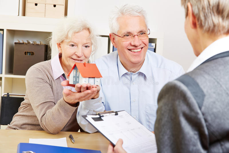 Download Senior Couple Buying Real Eastate Stock Photo - Image: 38207024
