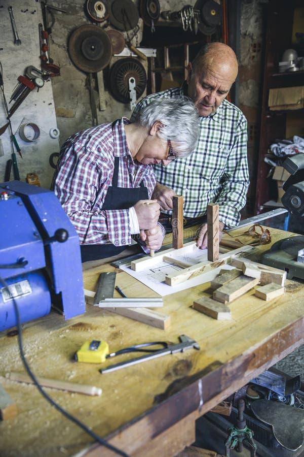 Senior couple in a carpentry stock photos