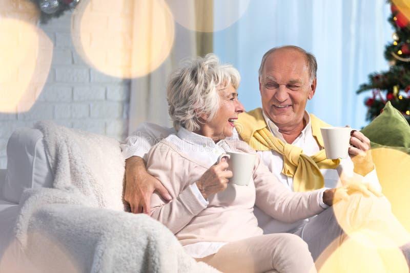 Senior couple and christmas time stock photos