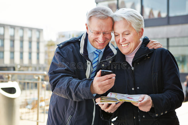 Senior couple with city guide app royalty free stock photo