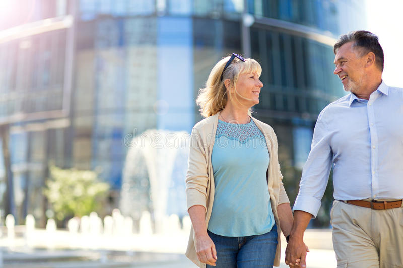 Senior Couple in the City. Loving Senior Couple Outdoors Smiling royalty free stock photo