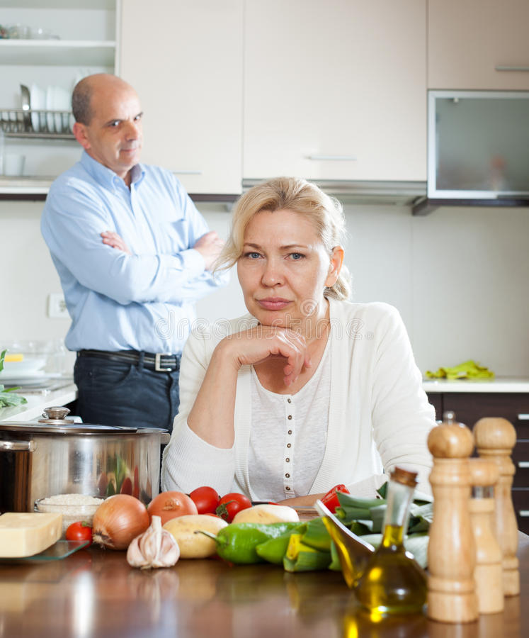 Senior couple conflicted at kitchen royalty free stock photography