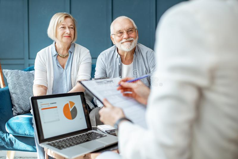Senior couple with consultant at the office royalty free stock photography