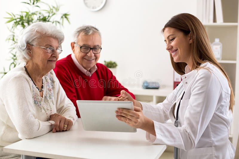 Senior couple on consultation with a doctor royalty free stock photos