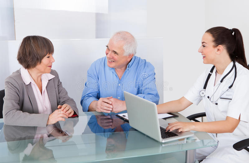 Senior Couple Consulting Doctor royalty free stock photography