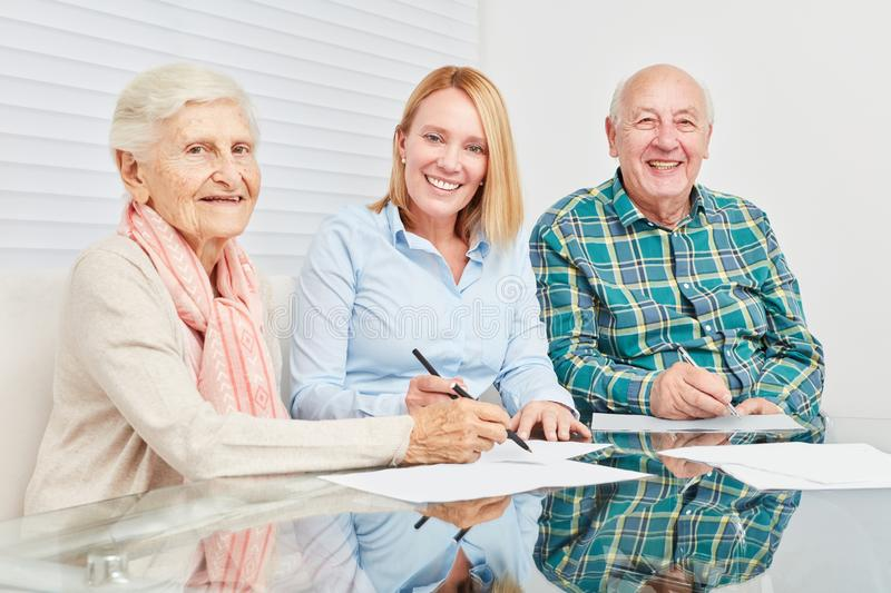 Senior couple with contract by consultant stock photography