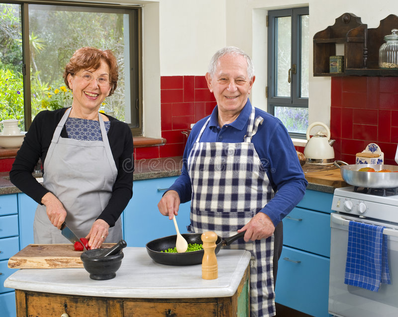 Senior Couple Cooking Stock Images