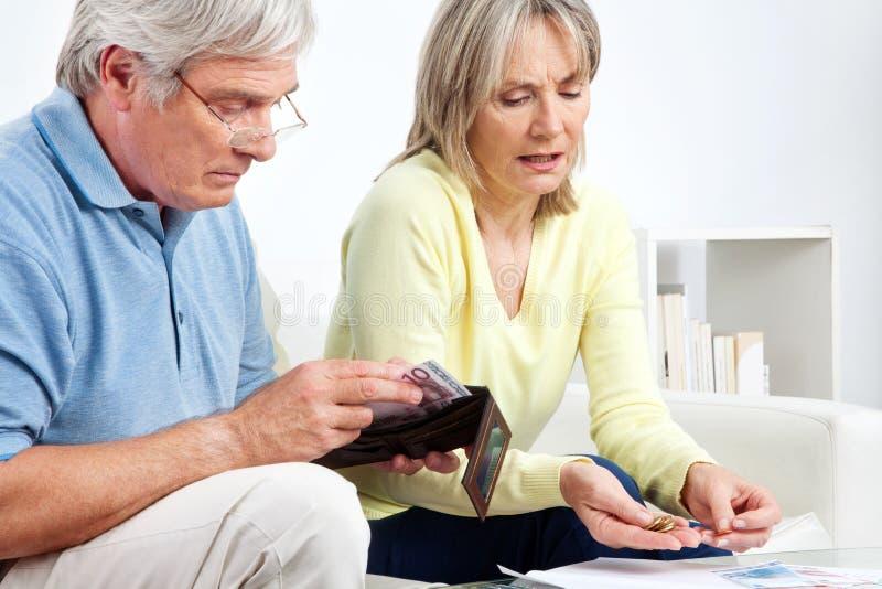 Senior couple counting money royalty free stock photo