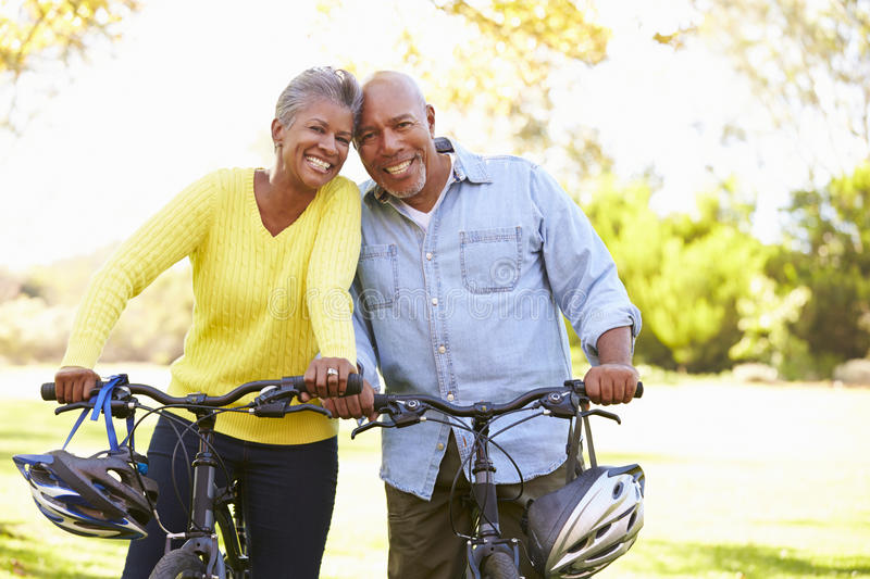 Download Senior Couple On Cycle Ride In Countryside Stock Photo - Image: 38639378
