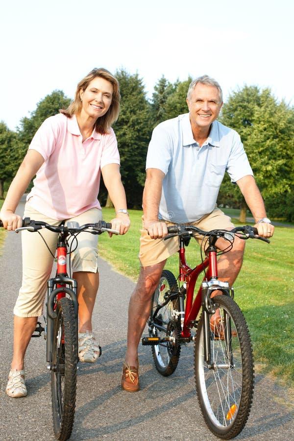 Senior couple cycling stock photos