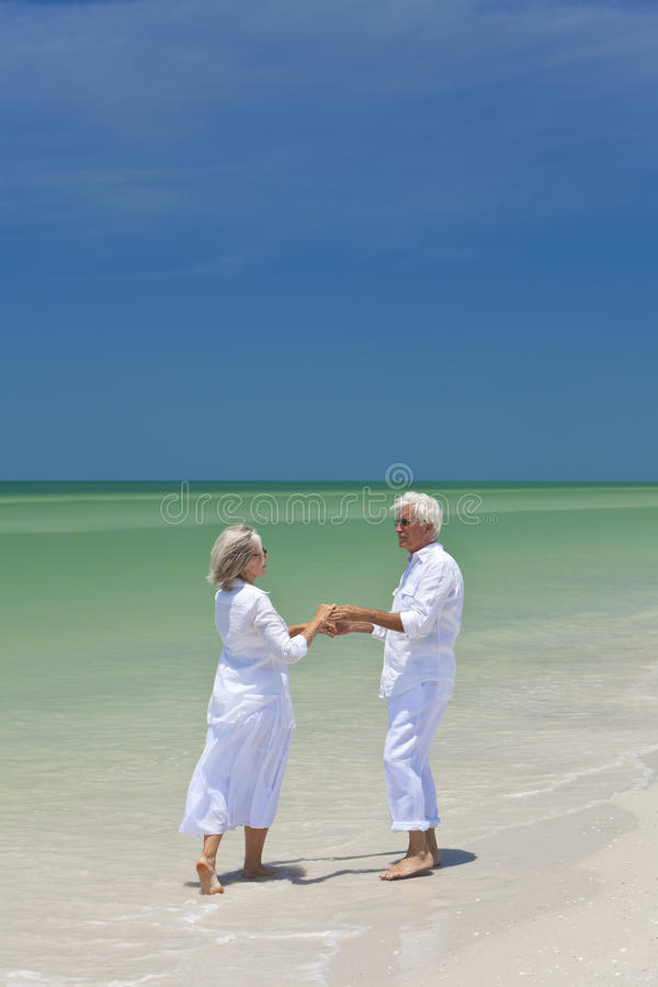 Download Senior Couple Dancing Holding Hands On A Beach Stock Image - Image of hair, female: 16689507