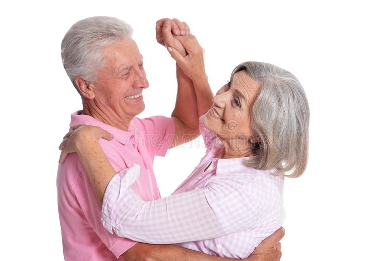 Senior couple dancing isolated on white background, full length. Portrait of senior couple dancing isolated on white background, full length stock images