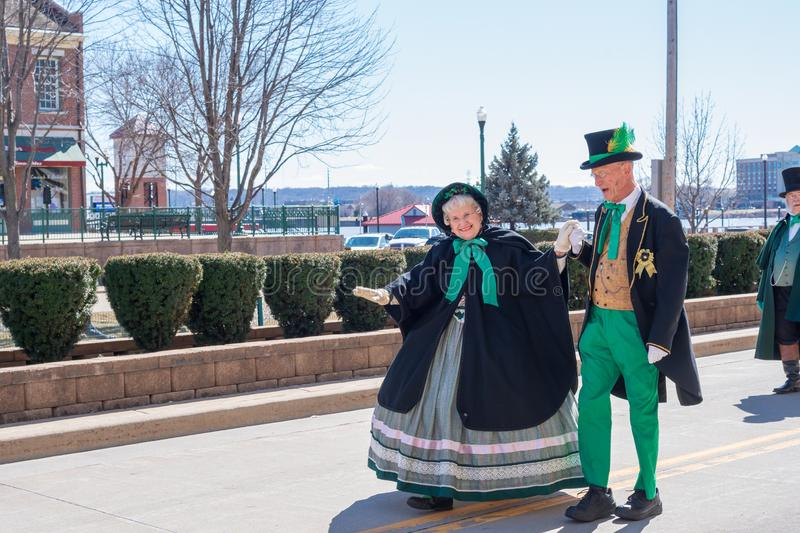 Senior couple dancing in St. Patrick`s Day parade royalty free stock photo