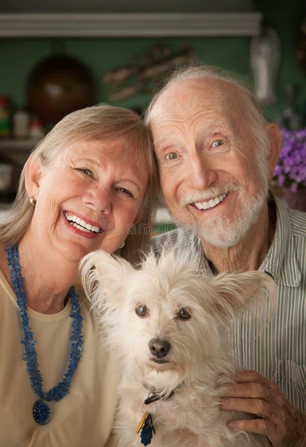 Senior Couple With Dog. Senior couple with cute white dog