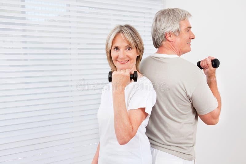Download Senior Couple Doing Dumbbell Stock Photo - Image of portrait, retirement: 23248930