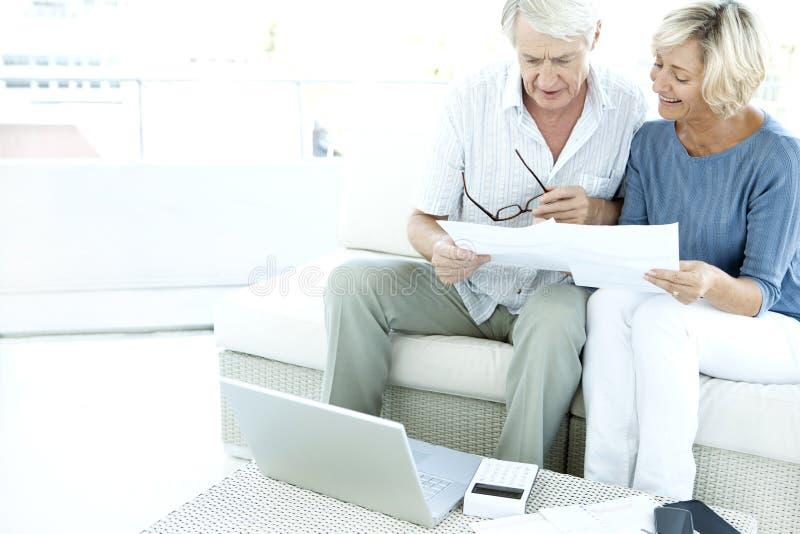 Senior couple doing home finances.  royalty free stock photography