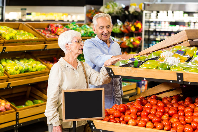 Senior couple doing some shopping together stock photography